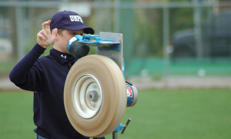 how does a pitching machine work?