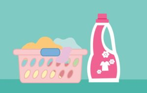 A drawing of a laundry basket and a detergent.