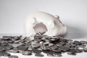 A broken white piggy bank.
