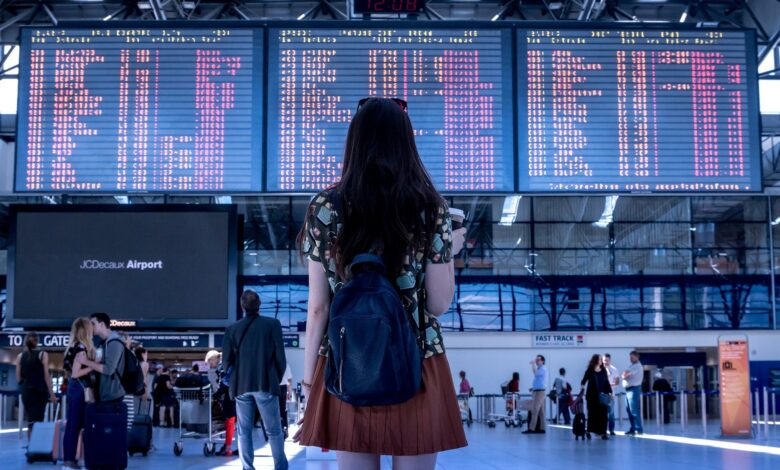 A girl at the airport after choosing one of the residential neighborhoods in Hong Kong to move to.