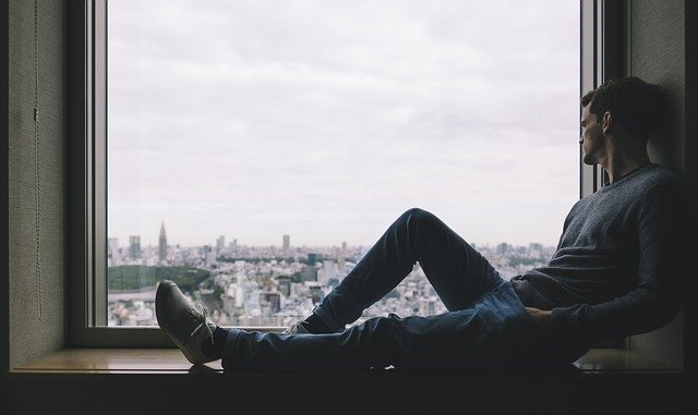 a man siting by the window