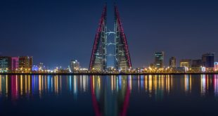An image of buildings in the night in Bahrain, read about exporting goods to Bahrain